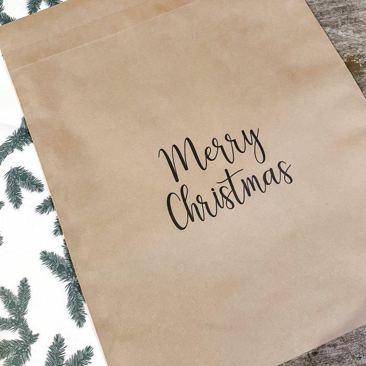 SHIPPING BAG ECO KRAFT MERRY CHRISTMAS Paquetes de 50 sobres 42x48cm